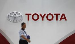 A man walks past Toyota Motor's logo at the company's showroom in Tokyo November 5, 2014.  REUTERS/Toru Hanai