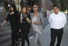 Companion of ex-NBA Clippers owner Donald Sterling, V. Stiviano (2nd R), walks out of the courthouse in Los Angeles, California March 26, 2015. REUTERS/Lucy Nicholson
