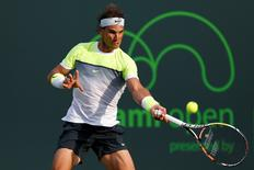 Mar 27, 2015; Key Biscayne, FL, USA; Rafael Nadal hits a forehand against Nicolas Almagro (not pictured) on day five of the Miami Open at Crandon Park Tennis Center. Nadal won 6-4, 6-2. Mandatory Credit: Geoff Burke-USA TODAY Sports