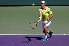 Mar 28, 2015; Key Biscayne, FL, USA; Kei Nishikori hits a forehand against Mikhail Youzhny (not pictured) on day six of the Miami Open at Crandon Park Tennis Center. Nishikori won 6-2, 6-1. Geoff Burke-USA TODAY Sports