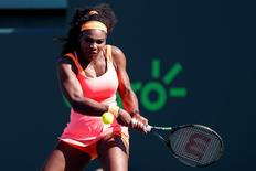 Mar 29, 2015; Key Biscayne, FL, USA; Serena Williams hits a backhand against Catherine Bellis (not pictured) on day seven of the Miami Open at Crandon Park Tennis Center. Geoff Burke-USA TODAY Sports