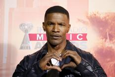 Actor and the evening's host Jamie Foxx makes a heart with his hands as he poses backstage at the 2015 iHeartRadio Music Awards in Los Angeles, California, March 29, 2015. REUTERS/Danny Moloshok