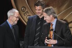 "Executive producer Graham Yost and actor Timothy Olyphant (C) smile with writer Elmore Leonard (L) after receiving a Peabody award for their work in ""Justified"" during the 70th annual Peabody Awards ceremony in New York May 23, 2011. REUTERS/Lucas Jackson"