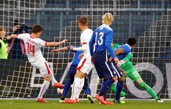 Valentin Stocker of Switzerland (L) scores against goalkeeper William Yarbrough of the U.S. during their international friendly soccer match at the Letzigrund Stadium in Zurich March 31, 2015. REUTERS/Arnd Wiegmann