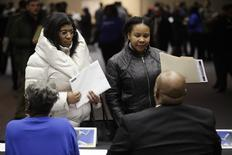 People attend a job fair in Detroit, Michigan, in this file photo taken March 1, 2014.     REUTERS/Joshua Lott