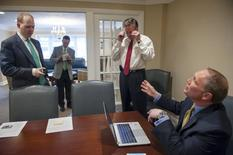 Lester H. Botkin (L) and Lester P. Botkin (C) meet with the vice president of business development at LPL Financial Doug Frank during the opening day of The Botkin Group's new offices in McMurray, Pennsylvania, March 20, 2015.  REUTERS/Stephanie Strasburg