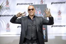 Vin Diesel poses for photographers during a handprint and footprint ceremony honoring the actor at the TCL Chinese Theatre in Los Angeles April 1, 2015. REUTERS/Phil McCarten
