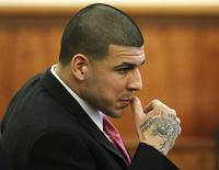 Former New England Patriots football player Aaron Hernandez sits during his murder trial at Bristol County Superior Court in Fall River, Massachusetts, April 2, 2015.  REUTERS/Steven Senne/Pool