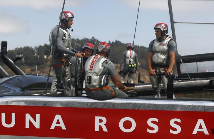 Crew members from Italy's Luna Rossa Challenge talk after being defeated by Emirates Team New Zealand in the sixth race of the Louis Vuitton Cup challenger series yacht race in San Francisco, California August 23, 2013. REUTERS/Robert Galbraith