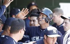 New York Yankees third baseman Alex Rodriguez (13) celebrates with teammates in the dugout after scoring during the fourth inning of a spring training baseball game against the Houston Astros at Osceola County Stadium. Mandatory Credit: Reinhold Matay-USA TODAY Sports