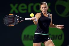 Apr 2, 2015; Key Biscayne, FL, USA; Simona Halep hits a forehand against Serena Williams (not pictured) in a women's singles semi-final on day eleven of the Miami Open at Crandon Park Tennis Center. Williams won 6-2, 4-6, 7-5. Mandatory Credit: Geoff Burke-USA TODAY Sports
