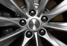 The logo is seen on a new all-wheel-drive version of the Tesla Model S car in Hawthorne, California October 9, 2014. REUTERS/Lucy Nicholson