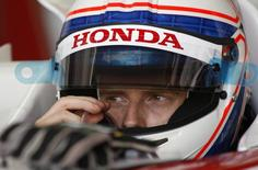 Formula One driver Anthony Davidson of Britain gestures inside his Super Aguri racing car during a training session at Catalunya's racetrack in Montmelo, near Barcelona, May 2, 2007. REUTERS/Albert Gea