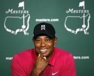 Tiger Woods of the U.S. smiles during a press conference at Augusta National held during practice rounds ahead of the 2015 Masters at the Augusta National Golf Course in Augusta, Georgia April 7, 2015.  REUTERS/Jim Young