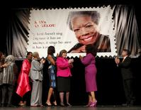 First lady Michelle Obama applauds during the Maya Angelou Forever stamp dedication ceremony in Washington April 7, 2015.  REUTERS/Kevin Lamarque
