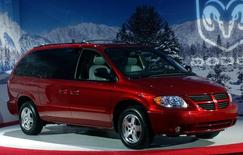 The new 2005 Dodge Caravan with 'Stow 'n Go' features is unveiled December 8, 2003 at DaimlerChrysler headquarters in Auburn Hills, Michigan.  REUTERS/Rebecca Cook