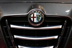 An Alfa Romeo logo is seen on a car displayed on media day at the Paris Mondial de l'Automobile, October 2, 2014. REUTERS/Benoit Tessier