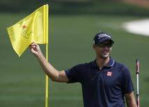 Adam Scott of Australia holds the second green flag during his practice round ahead of the 2015 Masters at Augusta National Golf Course in Augusta, Georgia April 8, 2015.   REUTERS/Jim Young