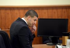 Former New England Patriots football player Aaron Hernandez sits after lunch break in the courtroom of the Bristol County Superior Court House in Fall River, Massachusetts April 8, 2015.  REUTERS/Faith Ninivaggigi
