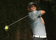 Tiger Woods of the U.S. hits a drive off the second tee during third round play of the Masters golf tournament at the Augusta National Golf Course in Augusta, Georgia April 11, 2015. REUTERS/Mark Blinch