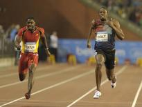 Usain Bolt of Jamaica (R) runs next to Justin Gatlin of the U.S. on his way to win the men's 100 metres during the IAAF Diamond League athletics meeting, also known as Memorial Van Damme, in Brussels September 6, 2013.   REUTERS/Laurent Dubrule