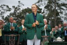 Jordan Spieth of the U.S. grins as he wears his Champion's green jacket on the putting green after winning the Masters golf tournament at the Augusta National Golf Course. REUTERS/Brian Snyder