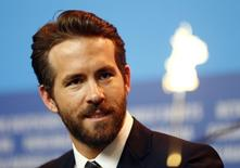 Actor Ryan Reynolds looks on during a news conference to promote the movie 'Woman In Gold' at the 65th Berlinale International Film Festival, in Berlin February 9, 2015. REUTERS/Hannibal Hanschke