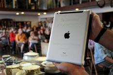 An Apple iPad which belonged to Pope Francis is seen at Castells auction house in Montevideo, April 14, 2015. REUTERS/Nicolas Garrido