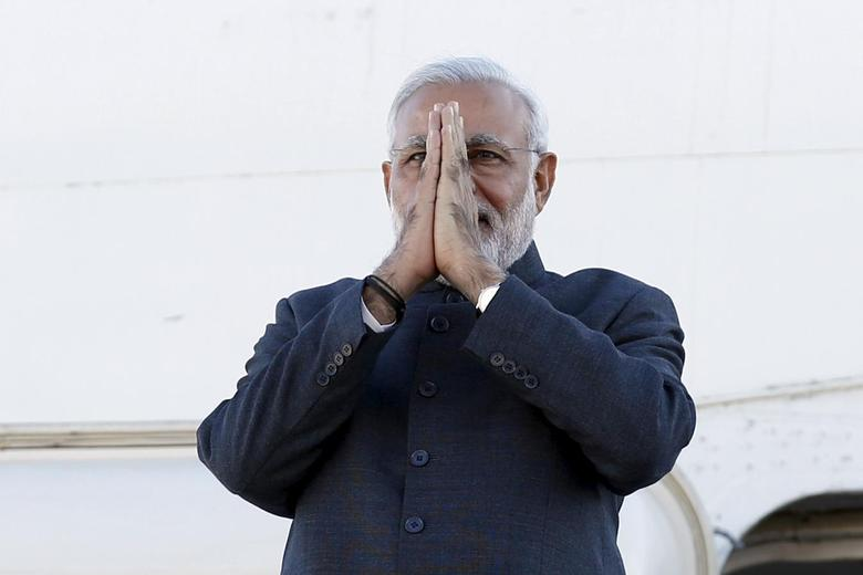 India's Prime Minister Narendra Modi gestures while disembarking his plane after arriving at the Ottawa International Airport April 14, 2015. REUTERS/Chris Wattie/Files