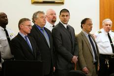 Former NFL player Aaron Hernandez stands with his defense attorneys as he hears his verdict in his murder trial at the Bristol County Superior Court in Fall River, Massachusetts, April 15, 2015.  REUTERS/Dominick Reuter