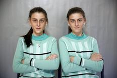 Twins Almedina (L) and Ajla Djulic pose for a portrait in a primary school in Buzim April 10, 2015. REUTERS/Dado Ruvic