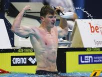 Adam Peaty of Britain celebrates after the men's 50m breaststroke semi-final at the European Swimming Championships in Berlin in this file photo taken on August 22, 2014. REUTERS/Michael Dalder