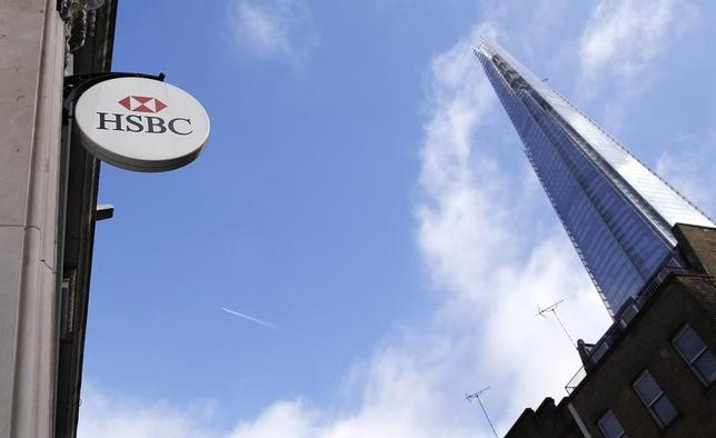 An HSBC sign is seen outside a bank branch near the Shard in London February 9, 2015.  REUTERS/Suzanne Plunkett