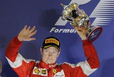 Ferrari Formula One driver Kimi Raikkonen of Finland celebrates his second place on the podium after Bahrain's F1 Grand Prix at Bahrain International Circuit, south of Manama April 19, 2015. REUTERS/Hamad I Mohammed