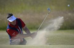 Nick Faldo of England hits out of a bunker on the 11th hole during a practice round ahead of the British Open golf championship at Muirfield in Scotland July 17, 2013.  REUTERS/Russell Cheyne