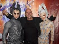 Guy Laliberte (C), CEO of Cirque du Soleil, poses with performers as he attends the premiere of Michael Jackson THE IMMORTAL World Tour show by Cirque du Soleil in Montreal, October 2, 2011.  REUTERS/Christinne Muschi/Files