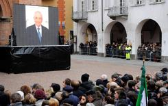 A picture of Michele Ferrero is displayed on a giant screen as people gather to pay respect during the funeral service in Alba February 18, 2015. REUTERS/Giorgio Perottino