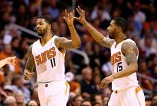 Jan 22, 2014; Phoenix, AZ, USA; Phoenix Suns forward Markieff Morris (left) celebrates a play with twin brother Marcus Morris against the Indiana Pacers in the first half at US Airways Center.  Mark J. Rebilas-USA TODAY Sports