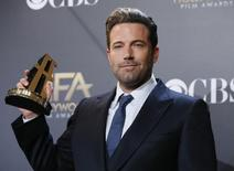 "Actor Ben Affleck poses backstage with the Hollywood film award, which he accepted on behalf of the creators, for ""Gone Girl"" during the Hollywood Film Awards in Hollywood, California November 14, 2014.  REUTERS/Danny Moloshok"