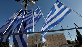 La Grèce ne présentera pas de liste de réformes économiques vendredi à Riga lors de la réunion des ministres des Finances de la zone euro, a déclaré un haut responsable de l'Union européenne, ajoutant qu'Athènes devrait pouvoir rester solvable jusqu'au mois de juin. /Photo d'archvies/REUTERS/Yorgos Karahalis