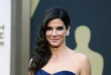 """Sandra Bullock, best actress nominee for her role in """"Gravity,"""" arrives at the 86th Academy Awards in Hollywood, California, in this file photo taken March 2, 2014.  REUTERS/Lucas Jackson/Files"""