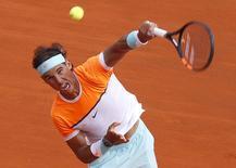 Rafael Nadal of Spain serves during his men's singles semi-final tennis match against Novak Djokovic of Serbia at the Monte Carlo Masters in Monaco, April 18, 2015.    REUTERS/Jean-Paul Pelissier