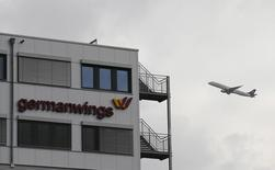 A Lufthansa aircraft flies past the headquarters of Germanwings during take-off from Cologne-Bonn airport March 27, 2015.   REUTERS/Wolfgang Rattay
