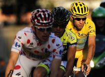 Astana team rider and Tour de France winner Vincenzo Nibali of Italy (R) cycles during the Tour de France Saitama Criterium race in Saitama, north of Tokyo October 25, 2014. REUTERS/Yuya Shino