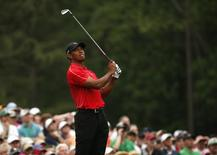 Tiger Woods of the U.S. watches his shot off the 12th tee during final round play of the Masters golf tournament at the Augusta National Golf Course in Augusta, Georgia April 12, 2015.   REUTERS/Jim Young