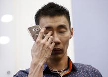 Malaysia's Lee Chong Wei wipes his eye at a promotional event in Kuala Lumpur, April 17, 2015. REUTERS/Olivia Harris
