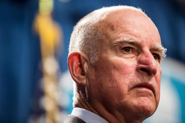 California Governor Jerry Brown looks on during a news conference at the State Capitol in Sacramento, California March 19, 2015. REUTERS/Max Whittaker