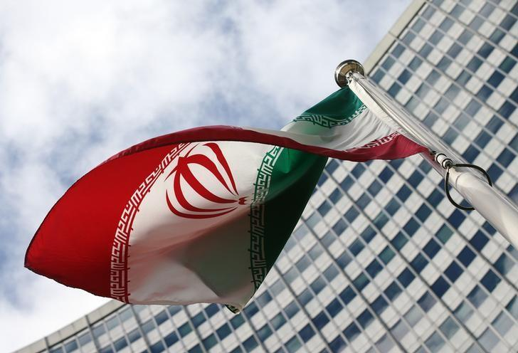 An Iranian flag flutters in front of the United Nations headquarters, during an International Atomic Energy Agency (IAEA) board of governors meeting, in Vienna, March 4, 2015.  REUTERS/Heinz-Peter Bader