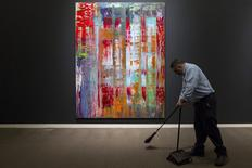 "A worker sweeps the floor in front of Gerhard Richter's ""Abstraktes Bild,"" estimated at a price in the region of $30 million, ahead of a preview event for Sotheby's upcoming evenings of impressionist, modern and contemporary art, in the Manhattan borough of New York City May 1, 2015.  REUTERS/Andrew Kelly"