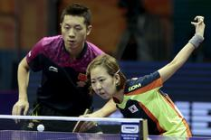 China's Xu Xin and South Korea's Yang Haeun play against Hong Kong's Wong Chun Ting and Doo Hoi Kem in their mixed doubles semi-final match at the World Table Tennis Championships in Suzhou, Jiangsu province, April 30, 2015. REUTERS/Aly Song